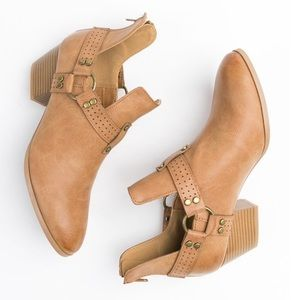In the details cutout booties, camel